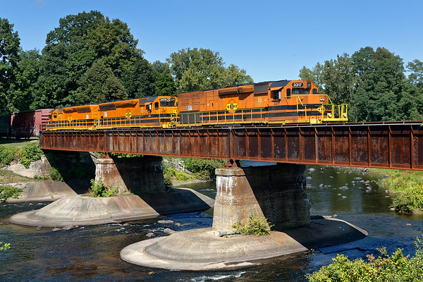 On a crystal clear late Summer day, NECR train 611 heads south across  the bridge at Three Rivers MA.<br /> 9/16/2019