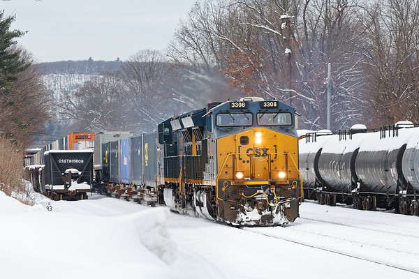 Meanwhile, as the snow jet was working the siding at MP83, Q022 eased through on the main.<br /> 12/4/2019