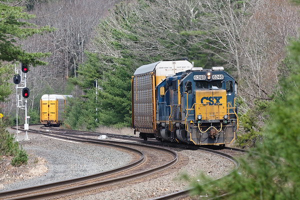 After Q264 squeezed another 120 car train onto the siding at MP60 in Spencer MA, B740, the Springfield Local, appeared with a single auto rack to add to the mix.<br /> 4/22/2019
