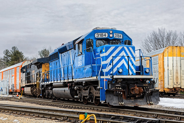 At the EBSR yard in East Brookfield MA, CEFX 3184 is MU'd to CSX 575 for switching duties.<br /> 3/14/2019