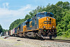 Q426 pulling up the Charlton Hill at MP57 with three CSX units on the point and a hint of purple...<br /> 7/5/2019