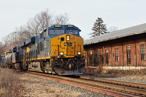 CSX train Q426 rolls past the old freighthouse near MP69 in West Brookfield MA.<br /> 1/7/2019