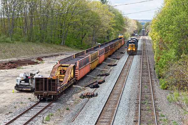 After dropping an autorack at the EBSR, B740 light power heads west past the tie train at MP64 in East Brookfield MA.<br /> 5/15/2019