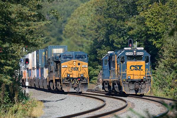 After dropping a single auto rack at the EBSR, B740 light power holds the siding just east of the crossover at CP60 as Q022 powers by on the main with a short train for Worcester.<br /> 9/27/2019