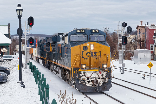 Train Q012 rolls through Palmer MA under dark skies as we transition from single digit daytime highs to expected 50s tomorrow.<br /> 1/23/2019