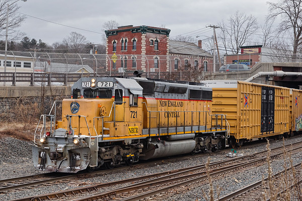 On a cold, dark winter morning, NECR 721 shoves a cut of cars into the CSX yard in Palmer MA.<br /> 1/29/2019