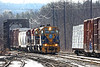 Shooting into the sun - train 608 crosses through the old iron bridge and pulls into the south end of the NECR yard in Palmer MA.<br /> 2/26/2019