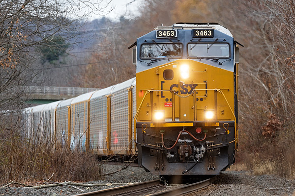 CSX train Q264 runs through West Warren MA with a long drag of auto racks for the EBSR.<br /> 11/14/2019