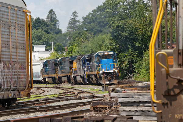 ED-8 eases into the Gardner MA yard with 4 units pulling - MEC 7542 (Smurf Nose) on the point, MEC (Pan Am) 3401, MEC 7541 and MEC 5930.<br /> 7/25/2019