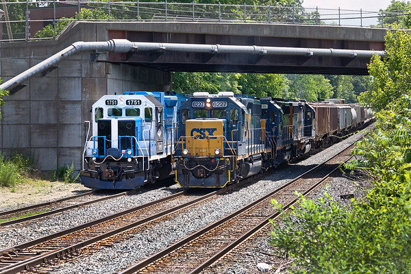 At MP83 in Palmer MA, MCER 1751 pulls a cut of cars out on the yard lead as B740 heads out of the yard on the controlled siding.<br /> 6/12/2019
