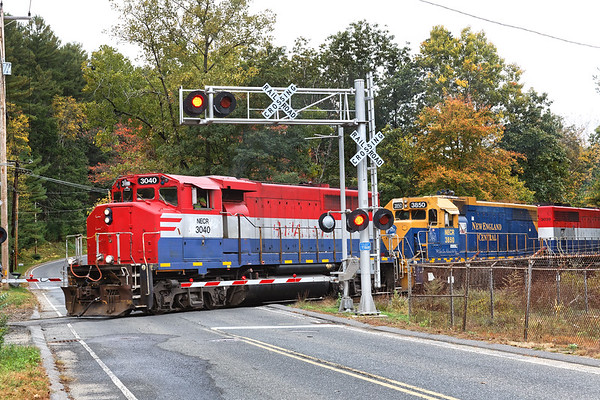 NECR 3040 leads 3850 and 3039 south from the NECR yard in Palmer MA.<br /> 10/8/2019