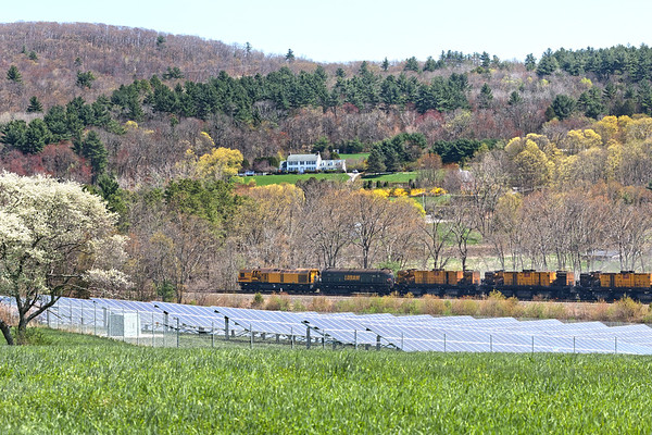 The early Spring landscape in Palmer and Brimfield is the backdrop for the LORAM rail grinder working it's way towards Warren MA.<br /> 4/29/2019