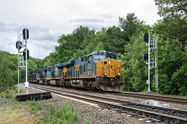 Train Q427 rolls through the signals at MP60 in Spencer MA.<br /> 6/17/2019