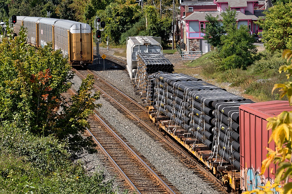 In Palmer MA, after temporarily dropping 4 auto racks on the siding, B740 backs a cut of pipe loads for the Mass Central onto the yard lead.<br /> 9/16/2019
