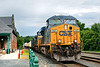 Q012 rolls past the depot at MP83 in Palmer MA.<br /> 7/2/2019