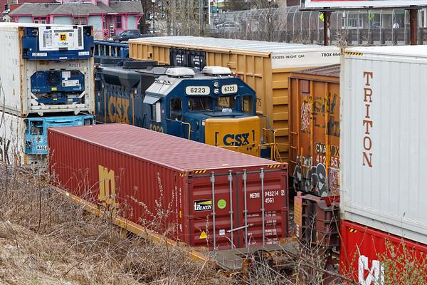 Railroad peekaboo - it looks like a tight squeeze on B740 as 022 rolls by!<br /> 4/15/2019
