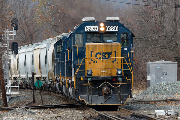Thank you to all veterans and those men and women who are currently serving.<br /> Train B740 hits the diamond at MP83 in Palmer MA on a dark, overcast late Fall day.<br /> CSX 6236 REALLY needs a cleanup!<br /> 11/11/2019