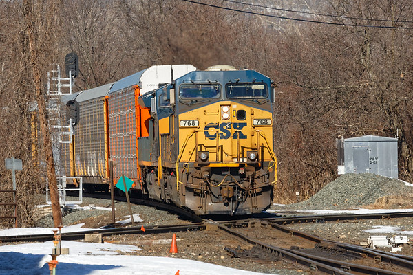 Due to a bridge strike just west of Palmer MA, trains were backed up this morning. First through is Q264 easing across the diamond at MP83.<br /> 3/13/2019