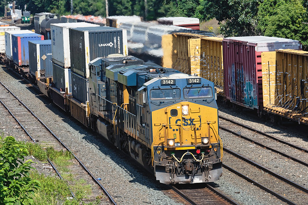 Train Q022 rolls through the CSX yard at MP83 with a short train of only 14 cars.<br /> 8/2/2019