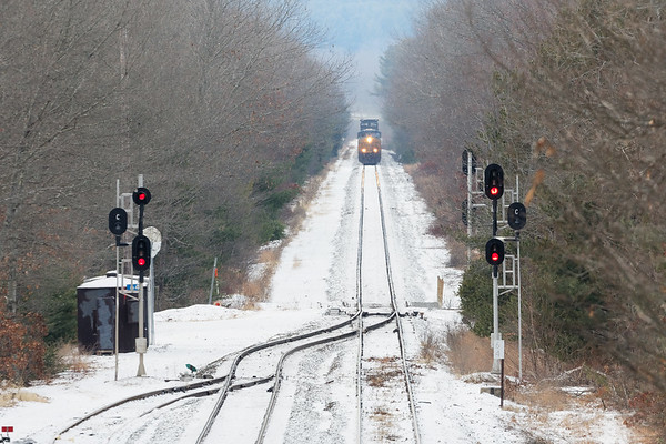 Q022 comes into view on the single track straightaway west of MP64 in East Brookfield MA.<br /> 12/21/19