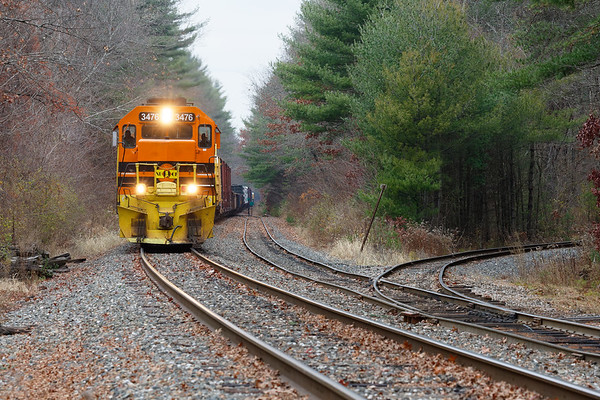 NECR train 611 at Barretts in Three Rivers MA, approaching the spur that leads into the Palmer Industrial Park.<br /> 11/11/2019
