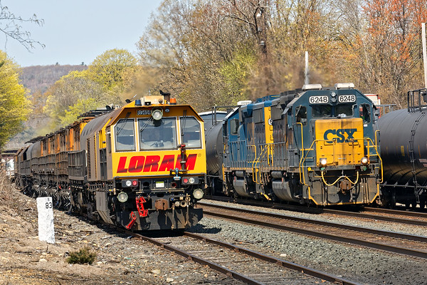 In the Palmer MA CSX yard, the LORAM railgrinder eases out onto the main as B740 comes into the yard on the controlled siding.<br /> 4/29/2019