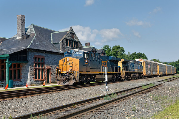Q264 rolls past the Palmer depot with a string of auto racks for the EBSR.<br /> 7/14/2019