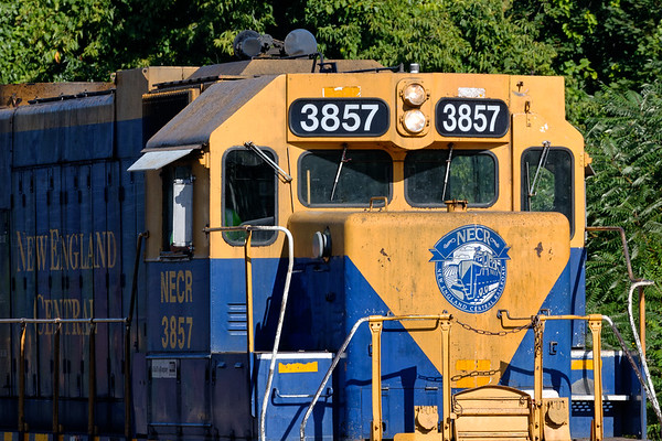 Are you ready for your close-up?<br /> In the early morning light, NECR 3857 works the yard at MP83 in Palmer MA.<br /> 9/3/2019