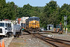 Meet you at the diamond!<br /> Q022 drifts through MP83 in Palmer MA as CSX crews gather to install PTC mandated auto derail switches on NECR's track on both sides of the diamond.<br /> 8/26/2019