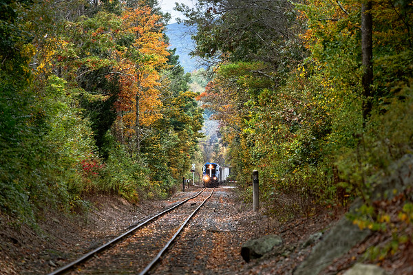 Country Railroading!<br /> The Fall colors are just beginning to appear as MCER 1750 pulls a line of hoppers through the crossing at West Warren Road in Ware MA.<br /> 10/2/2019