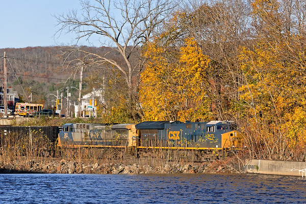 With two units on the point and a single DPU on the tail end, train Q426 runs through the remnants of this season's Fall foliage in West Warren MA.<br /> 11/1/2019