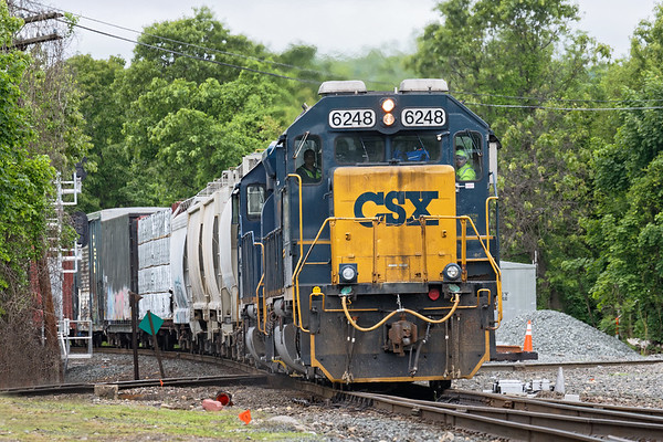 Train B740 rattles across the diamond and onto the siding at MP83 in Palmer MA.<br /> 5/29/2019