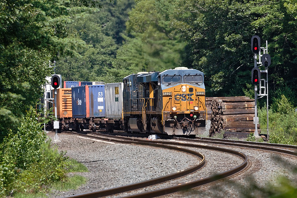 Running straight into the morning sun, Q022 hits the S-curves at MP60 in Spencer MA.<br /> 7/24/2019