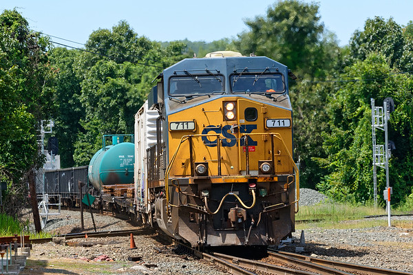 Train Q426 rattles across the Palmer MA diamond with one unit on the point and one mid-train DPU.<br /> 8/5/2019