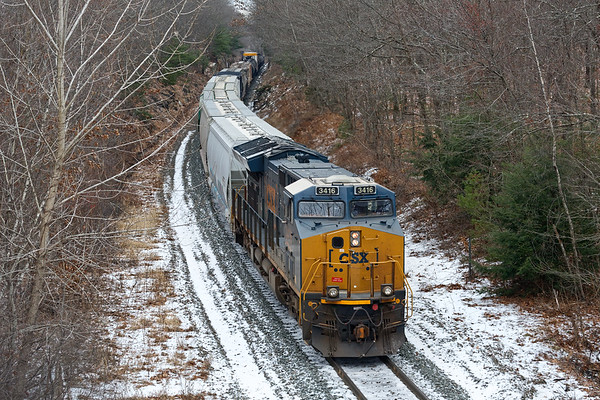 The lone pusher on the tail end of Q426 as it approaches the rock cut near the top of Charlton Hill.<br /> 12/26/2019