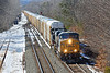 On a bitter cold and windy Winter day,  CSX train Q264 comes off the main straight onto the siding at MP64 in East Brookfield MA with a long drag of auto racks for the EBSR.<br /> 2/26/2019