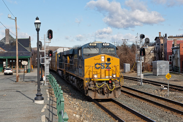 Train Q264 splits the signals at MP83 in Palmer MA with a long drag of auto racks for the EBSR.<br /> 4/1/2019