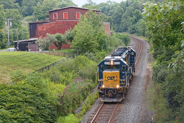 After dropping it's racks at the EBSR, B740 light power heads west past the old mill building in Brookfield MA.<br /> 8/13/2019