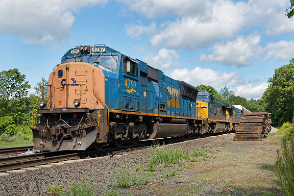 At MP60 in Spencer MA, Q264 backs down the siding with about 100 auto racks for the EBSR.<br /> 6/14/2019