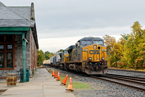 Train Q012 Rolls past the historic depot in Palmer MA.<br /> 10/8/2019