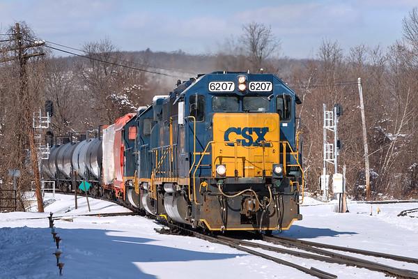 On a brilliant but frigid Winter morning, train B740 races across the Palmer MA diamond.<br /> 3/5/2019