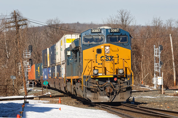 Within 5 minutes Q022 clatters across the Palmer diamond with a very small train and takes the main to leapfrog ahead of 264 which is on the siding.<br /> 3/13/2019
