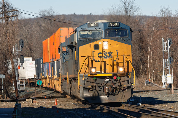 Running at track speed, CSX train Q022 slams across the diamond in Palmer MA with a short train for Worcester.<br /> 2/6/2019