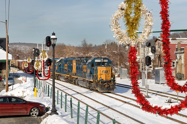 ****Merry Christmas to All****<br /> Running through a fresh blanket of light snow and framed by the Steaming Tender's Christmas decorations, train B740 eases into the CSX yard at MP83 in Palmer MA.<br /> 12/12/2019