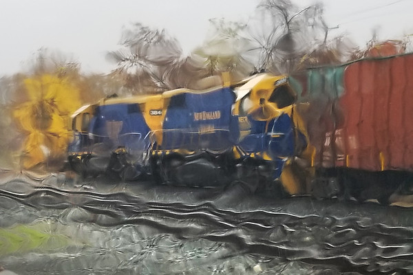 Pouring this morning so shooting through the windshield...<br /> NECR eases down the yard lead into the CSX yard at MP83 in Palmer MA.<br /> 10/31/2019