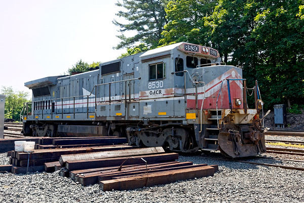 """OHCR 8530 sits tied down in the CSX yard at MP83 in Palmer MA. Word is that this is a """"new"""" unit destined for the NECR.<br /> 7/25/2019"""