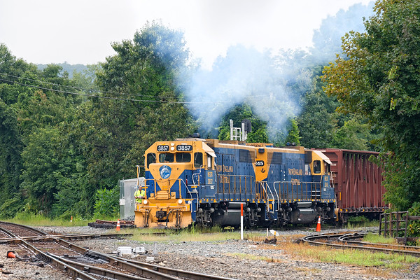 NECR train 603 puts on a smoke show as it crosses the diamond at MP83 in Palamer MA.<br /> 8/21/2019