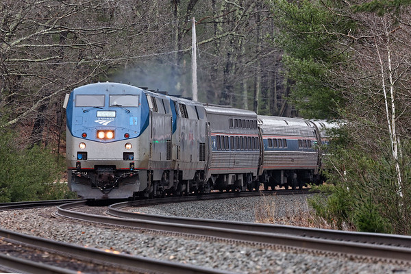On time Amtrak train 449 enters the S-curves at MP60 in Spencer MA.<br /> 4/8/2019