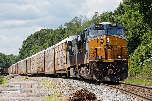 With Q426 holding the main, Q264 backs down through MP57 onto the siding.<br /> 7/24/2019