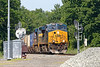 On a beautiful warm summer morning, CSX train Q012 splits the signals at MP57 in Charlton MA with a long train and 2 DPUs in the middle.<br /> 6/24/2019